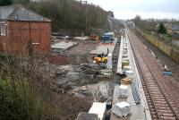 Ongoing work at Newtongrange, looking south on a wet 16 March 2015. The car park is starting to take shape on the left with work also underway on the direct link to the National Mining Museum at the far end of the platform.<br><br>[John Furnevel&nbsp;16/03/2015]