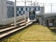 A city bound tram drops down from the E&G flyover towards the tram stop alongside Edinburgh Park station on 18 February 2015.<br><br>[John Furnevel&nbsp;18/02/2015]