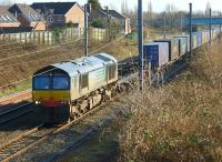 A Daventry to Coatbridge  container train with DRS 66429 in charge passes Oxheys loop to the north of Preston on the afternoon of 10 March 2015.<br><br>[John McIntyre&nbsp;10/03/2015]