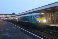 0618hrs at Llandudno Junction on 16th March and the Holyhead to Cardiff <I>Y Gerallt Gymro</I> funded service is running <I>right time.</I> DVT 82307 leads the train along the North Wales coast while 67029 is the propelling loco but the train will reverse at Chester forward the run south. (See recent news item)<br><br>[Mark Bartlett&nbsp;16/03/2015]