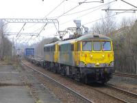 Freightliner 86637+86605 approaching Coatbridge Central on 17 March with the 14.01 Coatbridge FLT - Crewe Basford Hall containers.<br><br>[Bill Roberton&nbsp;17/03/2015]