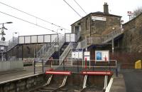 Bay platforms 3 and 4, the station building and its slightly 'Heath Robinson' connection to the footbridge at Springburn on 17th March 2015.<br><br>[Colin McDonald&nbsp;17/03/2015]