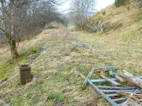 The surviving base of the former Fountainhall distant signal, looking north along the trackbed of the Lauder Light Railway on 18 March 2015.<br><br>[Bill Roberton&nbsp;18/03/2015]