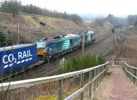 The late running 0616 Daventry - Mossend containers speed past a network Rail access point just south of Beattock summit on 18 March 2015. The lengthy train is double headed by DRS 68002+68004 <br><br>[John Furnevel&nbsp;18/03/2015]