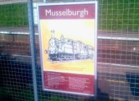 A Kenny Munro poster alongside the platform at Musselburgh station in March 2015, featuring North British locomotive 313 <I>'Musselburgh'</I> and the Robert Louis Stevenson poem <I>From a Railway Carriage</I>.<br><br>[John Yellowlees&nbsp;20/03/2015]