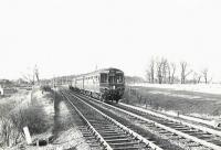 A Neilston High - Glasgow Central DMU drops down from Patterton towards Whitecraigs on 2 December 1960. <br><br>[G H Robin collection by courtesy of the Mitchell Library, Glasgow&nbsp;02/12/1960]