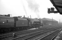 An up troop train photographed at Carlisle on 30 May 1964. The 10 coach 1X68 special is hauled by Stanier Pacific 46250 <I>City of Lichfield</I>. [Some (unconfirmed) sources suggest the train ran from Wemyss Bay to Euston.] This is one of at least two such specials that passed through Carlisle that day [see image 45618]. <br><br>[K A Gray&nbsp;30/05/1964]