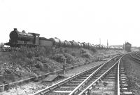Eastfield based J37 0-6-0 no 64632 with a train of empty tanks westbound near Clydebank East Junction on 4 September 1958. Clydebank East terminus, located behind the camera, closed to passengers in September 1959. [See image 7524]<br><br>[G H Robin collection by courtesy of the Mitchell Library, Glasgow&nbsp;04/09/1958]