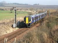 Slowing for the approach to Drem Junction on 19 March 2015, ScotRail emu 380105, forming the 1227 North Berwick - Edinburgh Waverley service, is about to leave the branch and join the east coast main line.<br><br>[John Furnevel&nbsp;19/03/2015]
