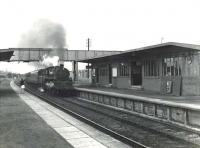 Delivered new from Doncaster Works to Parkhead shed the previous year,  BR Standard class 4 2-6-0 76103 is about to run through Drumry station on 16 September 1958 with a Singer workmen's train. <br><br>[G H Robin collection by courtesy of the Mitchell Library, Glasgow&nbsp;16/09/1958]