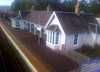 View north at Carrbridge on 23 March, with the station building gleaming in the early spring sunshine.<br> <br><br>[John Yellowlees 23/03/2015]