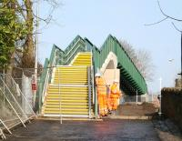 The new footbridge over the Borders Railway on Plumtreehall Brae, Galashiels, replacing the road bridge that previously crossed the line here. View north on 18 March 2015, at which time the bridge was not officially open, with finishing touches being applied. [See image 49909]<br><br>[John Furnevel&nbsp;18/03/2015]