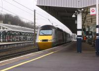 <I>Stand well back from the platform edge...</I>. A Virgin East Coast HST heads south at speed through Durham station on a dull 16 March 2015 on the 0952 Aberdeen to Kings Cross service.<br><br>[John McIntyre&nbsp;16/03/2015]