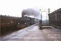 St Rollox Black 5 44718 brings a Buchanan Street - Dundee train into Stirling in February 1965.<br><br>[John Robin&nbsp;07/02/1965]