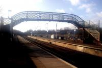 Looking north through Auchinleck station on 26 March 2015. When Auchinleck reopened in 1984, the footbridge came from Crookston, which had closed the previous year. Crookston itself reopened in 1990 but as a single-platform station.<br><br>[John Yellowlees&nbsp;26/03/2015]