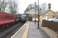 Scene at Stanhope station on 15 March 2015, with the Class 121 railcar preparing to depart for Wolsingham with the final round trip of the day. On the left the Mk 2 coaches which had previously been used for the <I>Polar Express</I>, wait for their transfer south (which took place on 20 March 2015).<br><br>[John McIntyre&nbsp;15/03/2015]