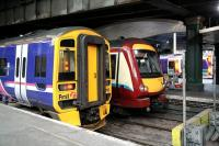 Colourful combination at the west end of Waverley in December 2006.<br><br>[John Furnevel&nbsp;02/12/2006]