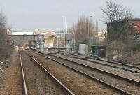 Looking towards Wrexham General on 15 March from the level crossing at Croes Newydd just south of the station. The bridge parapet on the right marks the point where the short branch to Wrexham Central passes under the main line. <br><br>[Mark Bartlett&nbsp;15/03/2015]