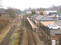 Looking west from Newgate Street bridge, Bishop Auckland on 17 March 2015. The present day single platform station is in the foreground with the Weardale Railway Bishop Auckland West station in the background. The once extensive railway facilities here have long gone with the land reclaimed for retail, car parking and a new road.<br><br>[John McIntyre 17/03/2015]