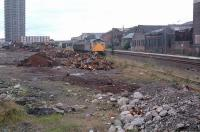 26011 shunting scrap wagons in the former Camlachie Goods Yard, here reduced to a single track serving a scrapyard in 1988. [See image 51978]<br><br>[Ewan Crawford&nbsp;//1988]