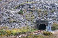 The southern portal of the 2 mile 333 yards Ffestiniog Tunnel in March 2015. The contrast between the rural area around the northern portal at Roman Bridge and the <I>moonscape</I> found when emerging here is always amazing and the train continues through the slate heaps for almost a mile to the present day station. One of Blaenau's numerous old inclined planes can be seen top left.<br><br>[Mark Bartlett&nbsp;15/03/2015]