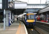 The 1013 Dunblane - Glasgow Queen Street boards at Stirling platform 3 on 1 April 2015, while the Abellio launch celebrations continue over on platform 2.<br><br>[John Furnevel&nbsp;01/04/2015]