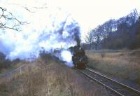 Standard tank 80046 makes steamy progress past Thorntonhall goods siding on the climb up from Busby with the 1708 St Enoch - East Kilbride in April 1966.<br><br>[John Robin&nbsp;/04/1966]