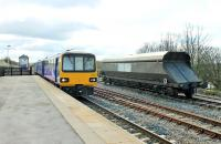 The Leeds to Heysham Port <I>Boat Train</I> slows for the Hellifield stop on Easter Saturday 2015. Three car 144022 is just passing a Freightliner coal wagon that was presumably removed from an S&C freight due to a problem. <br><br>[Mark Bartlett&nbsp;04/04/2015]