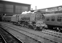 Stanier Pacific 46240 City of Coventry stands on the centre road at Carlisle on 12 April 1963, having just come off the 10.5am Glasgow Central - Birmingham New Street. The train is at platform 4, now in the hands of BR Britannia Pacific no 70044 <I>'Earl Haig'</I>, waiting to restart its journey south. [See image 35550]<br><br>[K A Gray&nbsp;12/04/1963]