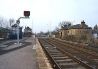 Looking north over the level crossing at Heighington on 18 March 2015. This station is on the route of the Stockton & Darlington Railway and opened for passengers on the same day that line was opened in September 1825. The building on the right is named 'The Locomotion No.1'.<br><br>[John McIntyre&nbsp;18/03/2015]