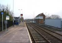 Looking south over the level crossing at Heighington towards Darlington on 18 March 2015. A new REB has appeared on the right next to the signalbox and new LED signals protect the crossing.<br><br>[John McIntyre&nbsp;18/03/2015]