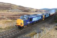 DRS 37607 and 37218 traveling fast on the approach to Tomatin on 6 April 2015 with the Pathfinder 1Z73 Inverness-Eastleigh railtour. <br><br>[John Gray&nbsp;06/04/2015]
