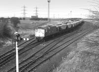26006 waits to leave Cockenzie Power Station siding on 9 March 1981 with a train of empty hoppers. <br><br>[Bill Roberton&nbsp;09/03/1981]