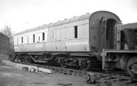 Former LMS brake coach, branded for Tartan Arrow / Security Coach /   Raleigh Industries Ltd. Presumably at McMullen Bros, Gartsherrie, for scrap in November 1977. [Ref query 6892]<br><br>[Bill Roberton&nbsp;/11/1977]
