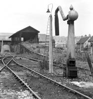 By the time of this photograph in September 1970, the coaling and watering facilities at Tweedmouth MPD had lain out of use for over four years, while the much longer disused roundhouse beyond had already been sold out of railway ownership to builders' merchants J. T. Dove.<br><br>[Bill Jamieson&nbsp;19/09/1970]