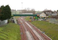 The last of the many new bridges to be built over the Borders Railway [see recent news item]. View is north towards Shawfair station in light rain on 12 April 2015, with work well underway. Part of the platforms and station footbridge at Shawfair are visible just beyond the new structure. Harelaw is on the right, with Newton village off picture to the left.<br><br>[John Furnevel&nbsp;12/04/2015]