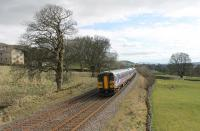 The 1449 Leeds to Carlisle service has just left Settle and is approaching the footbridge at Langcliffe on Easter Saturday 2015. 153330 is leading 158908 as they head for the next stop at Horton-in-Ribblesdale.<br><br>[Mark Bartlett&nbsp;04/04/2015]