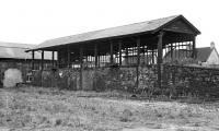 The business side of the old coaling stage at Tweedmouth in 1970, obviously capable of dealing with two locos at any one time. If necessary, the far side could probably have been modified to coal locos from there as well, but the number of tenders and bunkers requiring to be replenished at any one time presumably never justified this. The blocked up entrance to the roundhouse is on the left.<br><br>[Bill Jamieson&nbsp;19/09/1970]