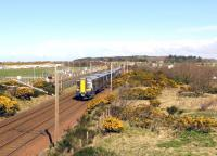 The 10.04 Glasgow Central to Ayr passing through the site of Monkton Station on 16 April 2015. The Prestwick Airport fuel discharge siding is on the left. [See image 14194]<br><br>[Colin Miller&nbsp;16/04/2015]