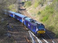 Scotrail-liveried 68007 joins the 'sub' at Craiglockhart Junction with the Motherwell - Edinburgh empty stock working for the Fife commuter service on 17 April.<br><br>[Bill Roberton&nbsp;17/04/2015]