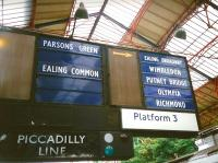 When I photographed these fine old platform indicators at Earls Court in 1994 I wouldn't have believed that they would still be there 21 years later. In fact the left-hand column has been supplemented with a 'STOPS HERE' at the bottom.  Inflexible, but simple and effective.<br> <br> <br><br>[David Panton&nbsp;14/07/1994]