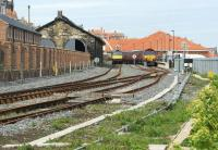 Looking east towards Whitby station on 13 April 2015 with a NYMR service in platform 1 on the left and a railtour from Chester at platform 2. Platform 2 was re-instated in 2014 and includes a run round loop to release a locomotive, although on this occasion both trains were top and tailed. The NYMR train has Class 25 D7628 with Black 5 no. 45407 at the other end, while the railtour has 66142 nearest and 66005 at the buffers.<br><br>[John McIntyre&nbsp;13/04/2015]