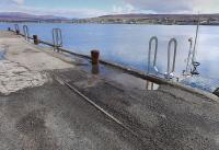 Surviving rails of the Skye Marble Railway on the pier at Broadford on 16 April 2015 [see image 51016].<br><br>[Bill Roberton&nbsp;16/04/2015]