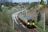 318262 coming round the reverse curves south of Carluke on the approach to Braidwood.<br><br>[Ewan Crawford&nbsp;21/04/2015]