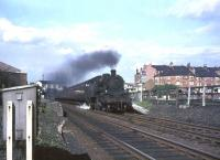 The 5.33pm St Enoch - East Kilbride hurries south through Crossmyloof station on 25 May 1965 behind BR Standard tank 80058.<br><br>[John Robin&nbsp;25/05/1965]