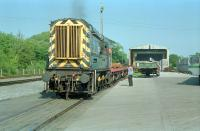 08675 shunting flatbeds carrying steel sections at Stockton Haulage, Stranraer, in 1989.<br><br>[Ewan Crawford&nbsp;//1989]