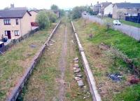 View west over Caldercruix in 1997. It is now odd to think that then the station had been closed for forty one years and the line had been closed for around fifteen years, it would remain closed for a further thirteen years but now has been open as a modern electrified railway for five years.<br><br>[Ewan Crawford&nbsp;//1997]