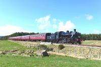 Ivatt Class 2 No.46512 passes the site of Broomhill Junction on the Strathspey Railway on 11 April 2015 with the early afternoon train for Broomhill. <br><br>[John Gray&nbsp;11/04/2015]