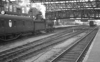 An afternoon arrival drifts into platform 4 at an otherwise quiet looking Carlisle station on Saturday 3 September 1960. The train is the 12.25pm stopping service from Hawick and the locomotive ex-NB class D34 4-4-0 62488 <I>Glen Aladale</I>. <br><br>[K A Gray&nbsp;03/09/1960]
