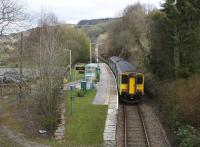 The 1511 Blaenau Ffestiniog - Llandudno service passes the former island platform of the well kept but now quiet Dolwyddelan station on 14th April 2015. The station also had a goods loop and shed serving a slate quarry on the hill to the right.<br><br>[Colin McDonald&nbsp;14/04/2015]